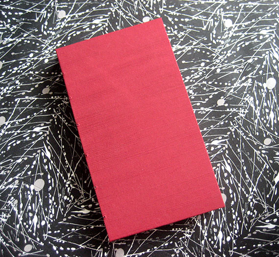 Red silk lie-flat sketchbook - front view