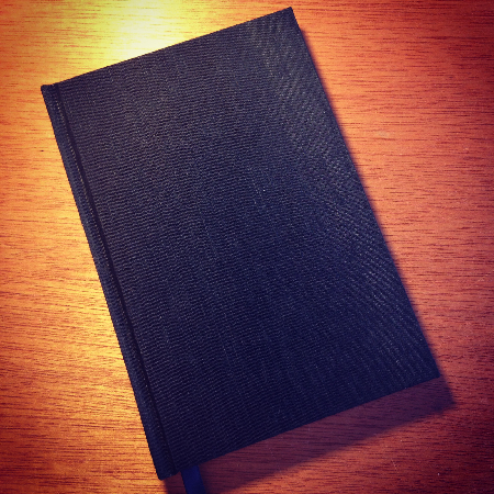 Black silk hardcover notebook