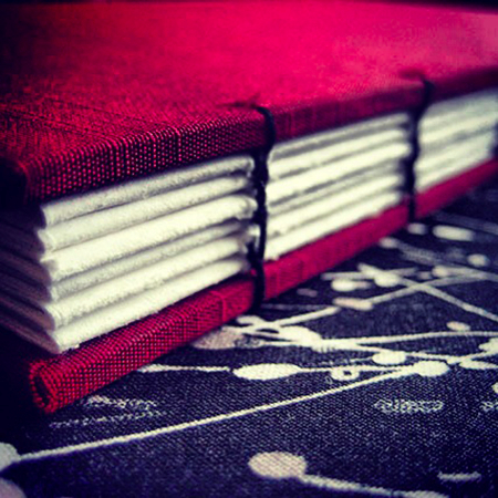 Red silk lie-flat sketchbook - spine view