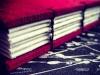 Red silk lie-flat sketchbook - spine view