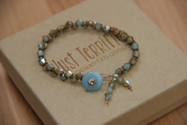 Crystal beaded bracelet with antique button