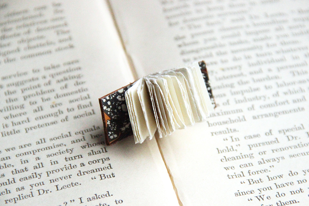 up cycled leather transformed into a mini book