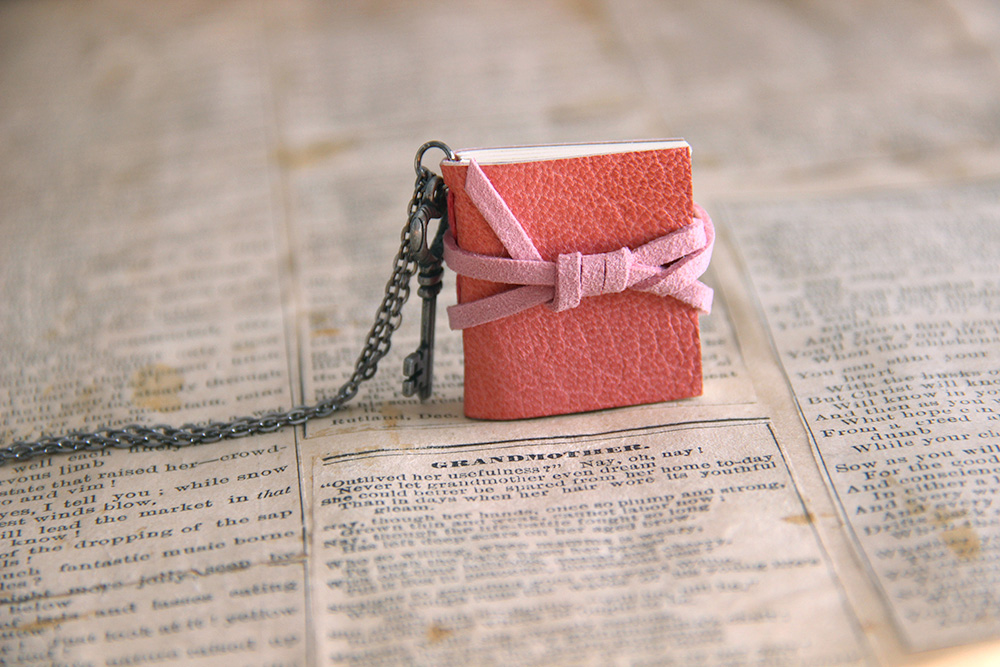key necklace with a handmade pink book