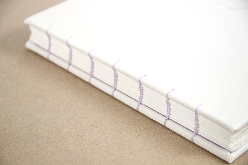Coptic binding on a handmade book by Rachael Gootnick