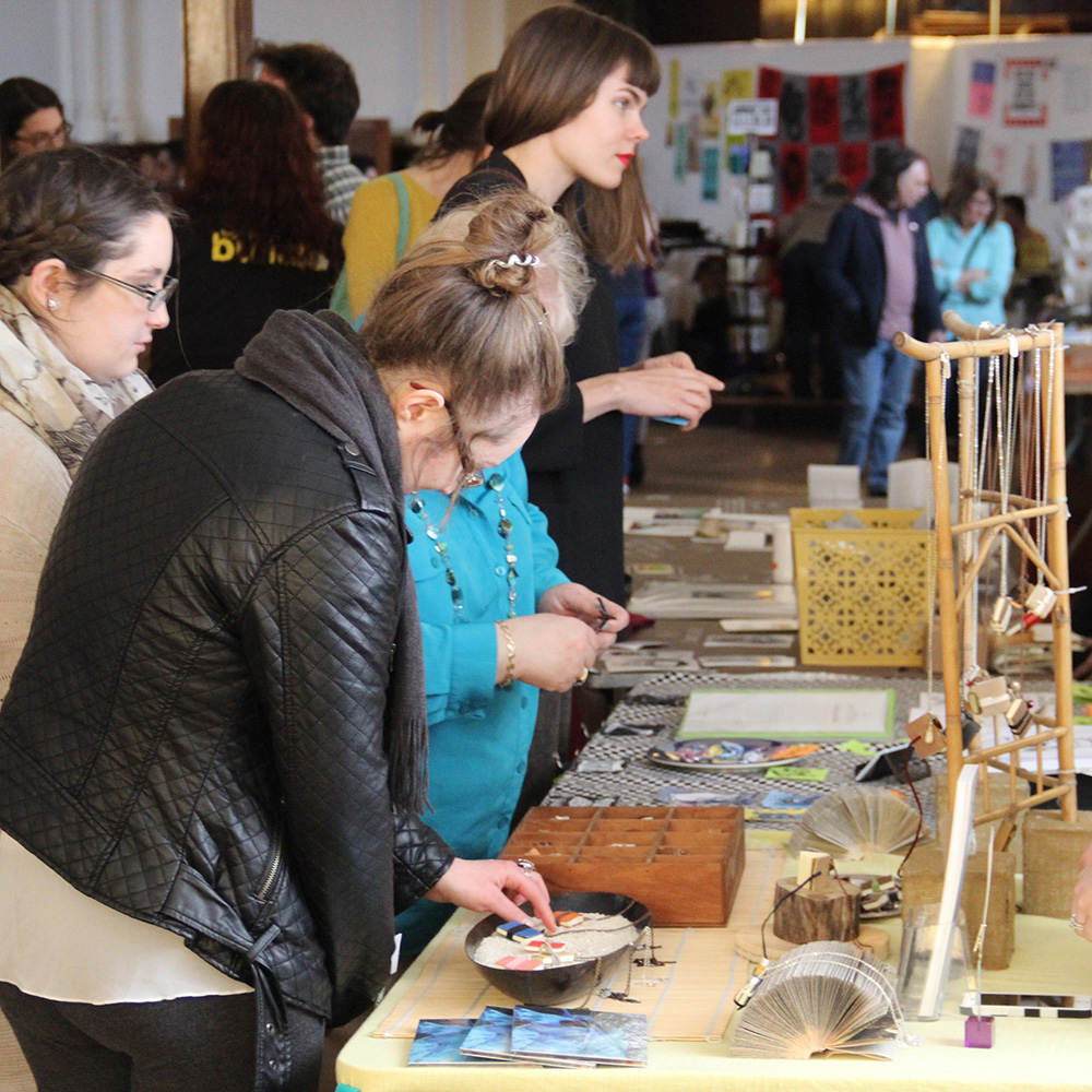 Handmade book art and book jewelry at a craft show in Rochester, New York