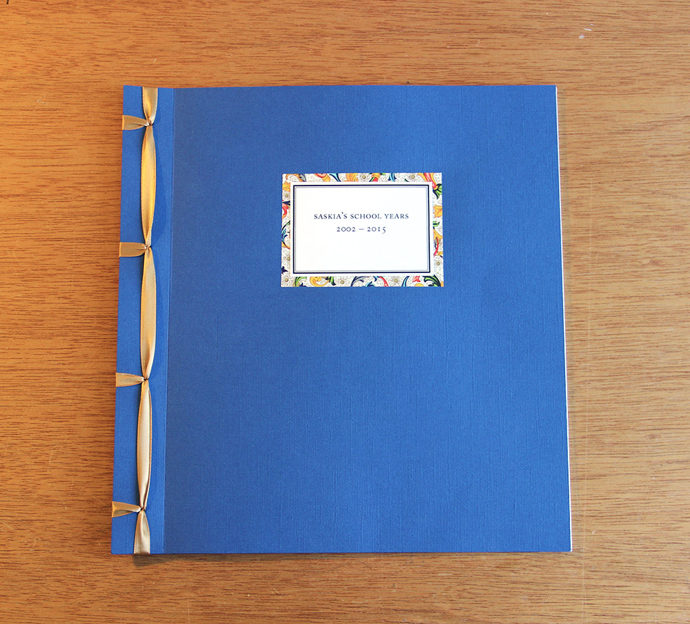 Stab binding ribbon on a memory book