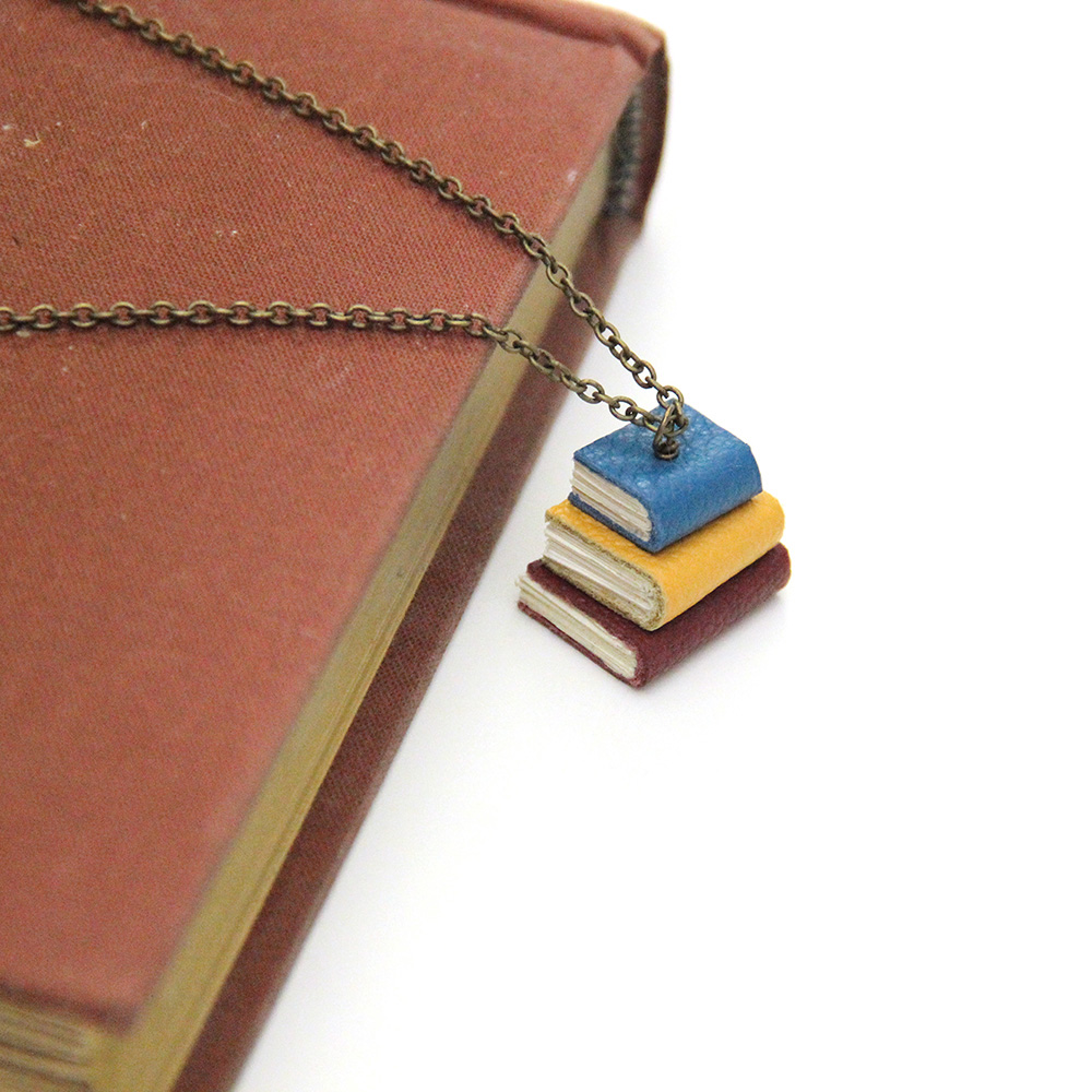 stacked book necklace including 3 tiny books