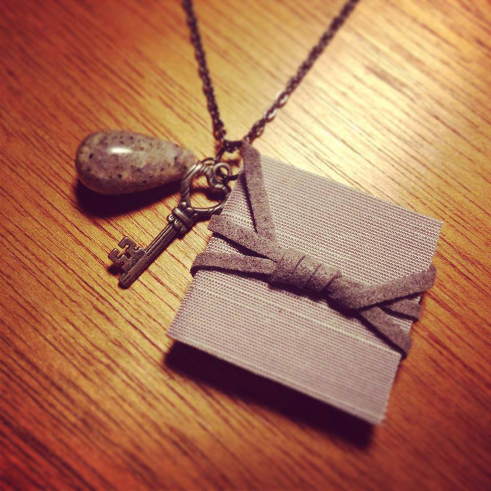 vegan leather mini book on a necklace