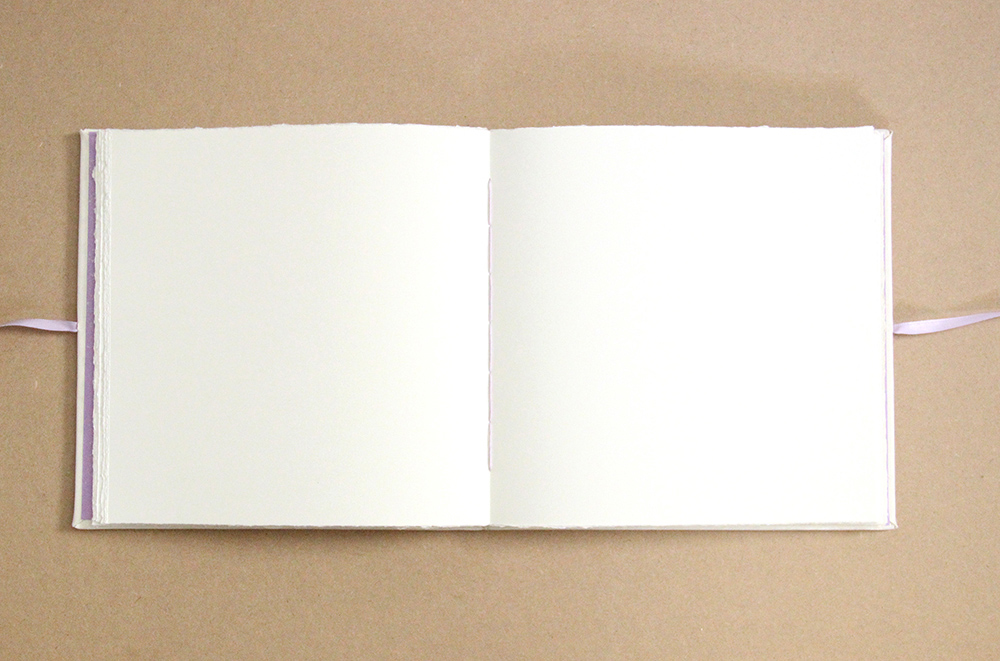Inside of a custom made wedding book made in the USA