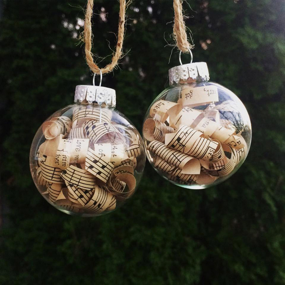 Holiday gift ideas for a book lover, music lover, teacher, or librarian. Book page ornaments made in New York by a female artist.