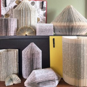 Artwork created out of pages from a book available for purchase on the East Coast