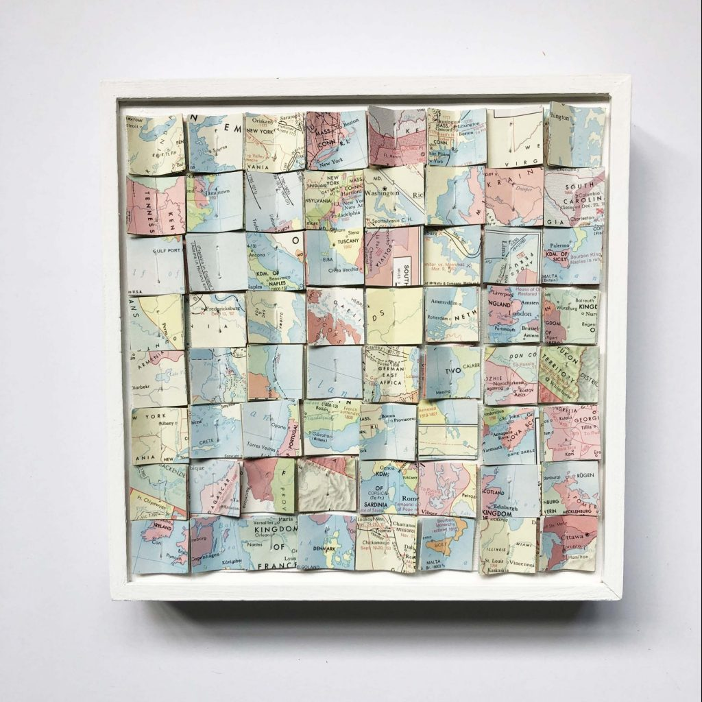 folded map pages as wall art