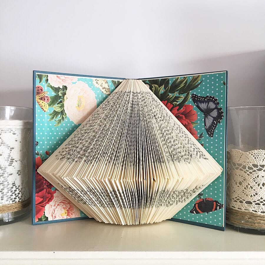 folded book pages to create a three-dimensional art sculpture