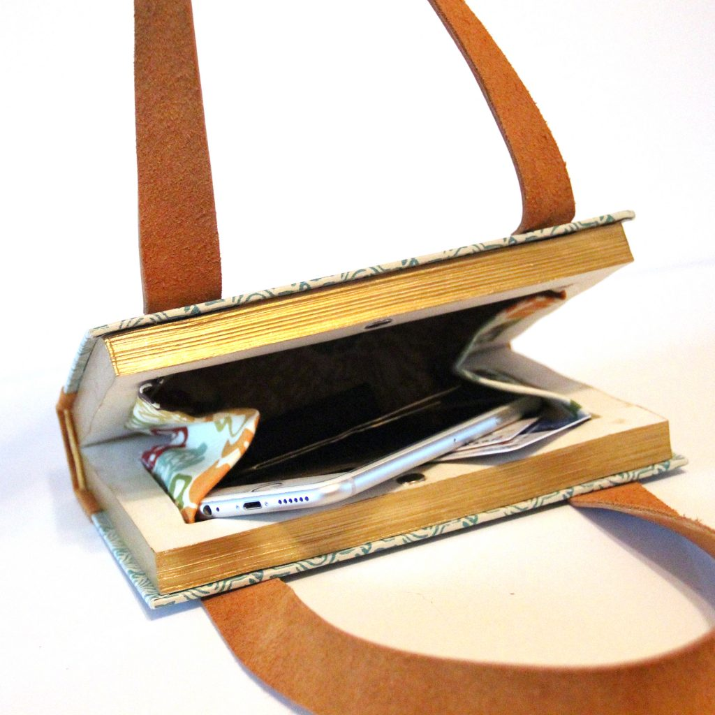 the inside of a book is reinvented into a purse