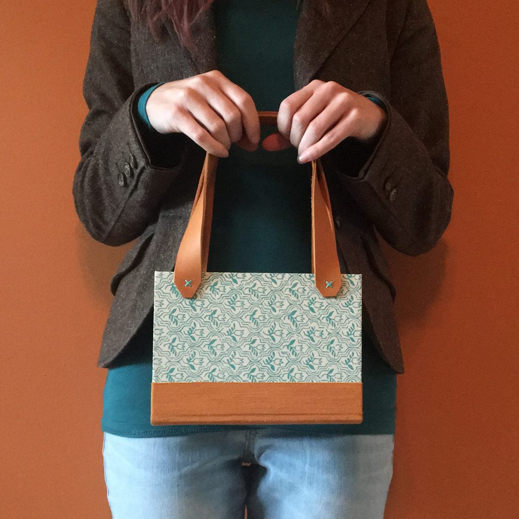 upcycled book is used to create a purse