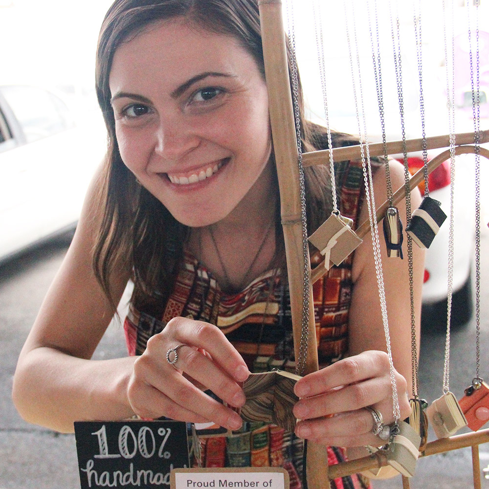 Rachael Gootnick with her book necklace display