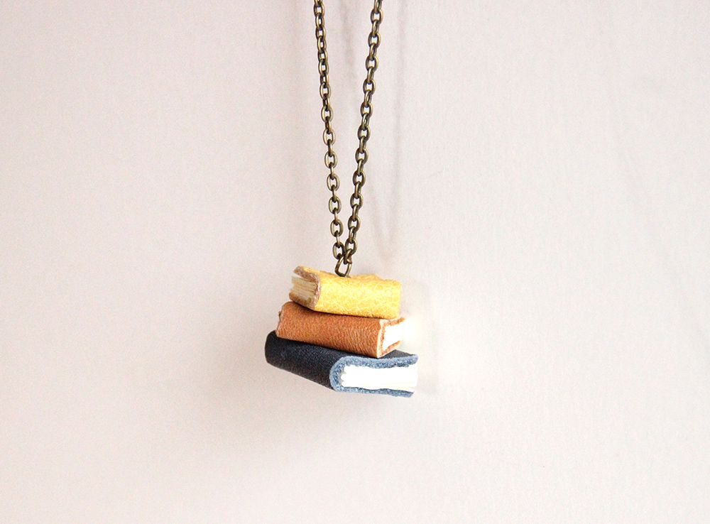 Small handmade books created into a book lover necklace