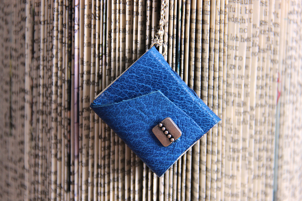Just Terrific blue tiny book necklace
