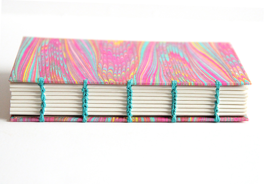 Bright marbled paper cover of a coptic book