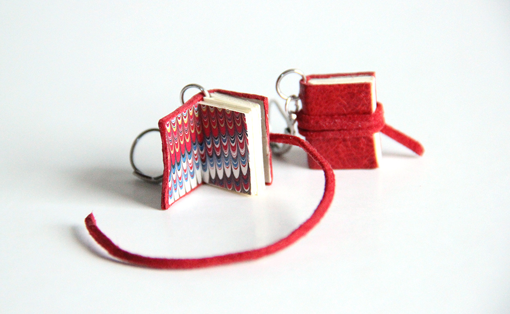 The inside of a tiny homemade book (set of earrings)