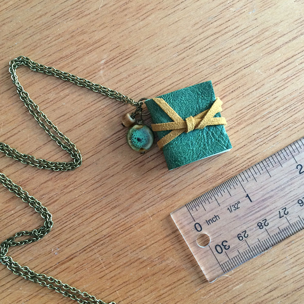 Teal and yellow handmade long book necklace
