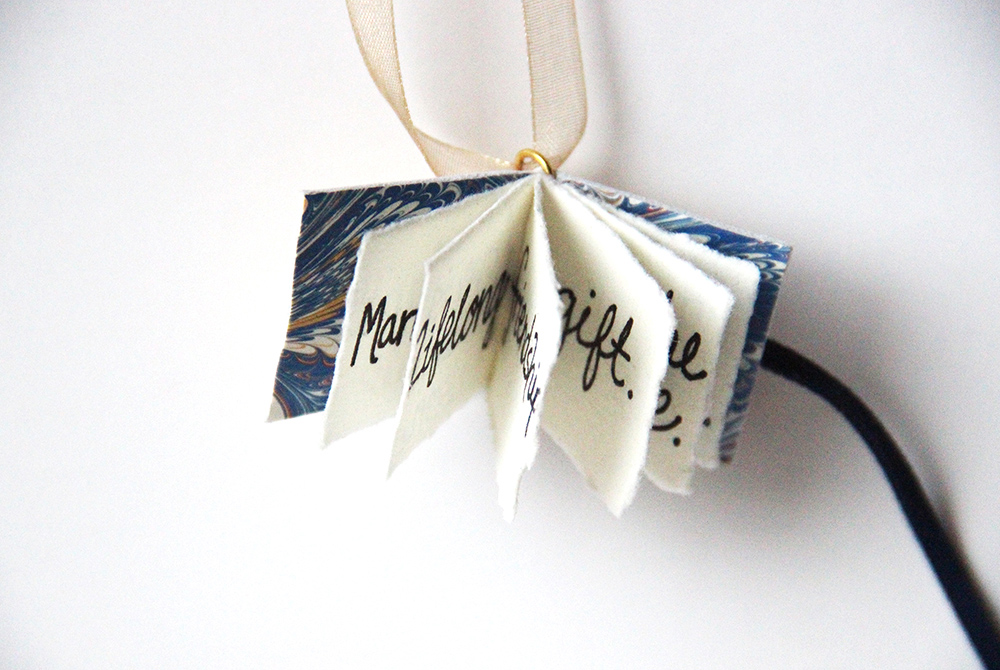 Custom wedding book charm available as a unique wedding gift off the registry